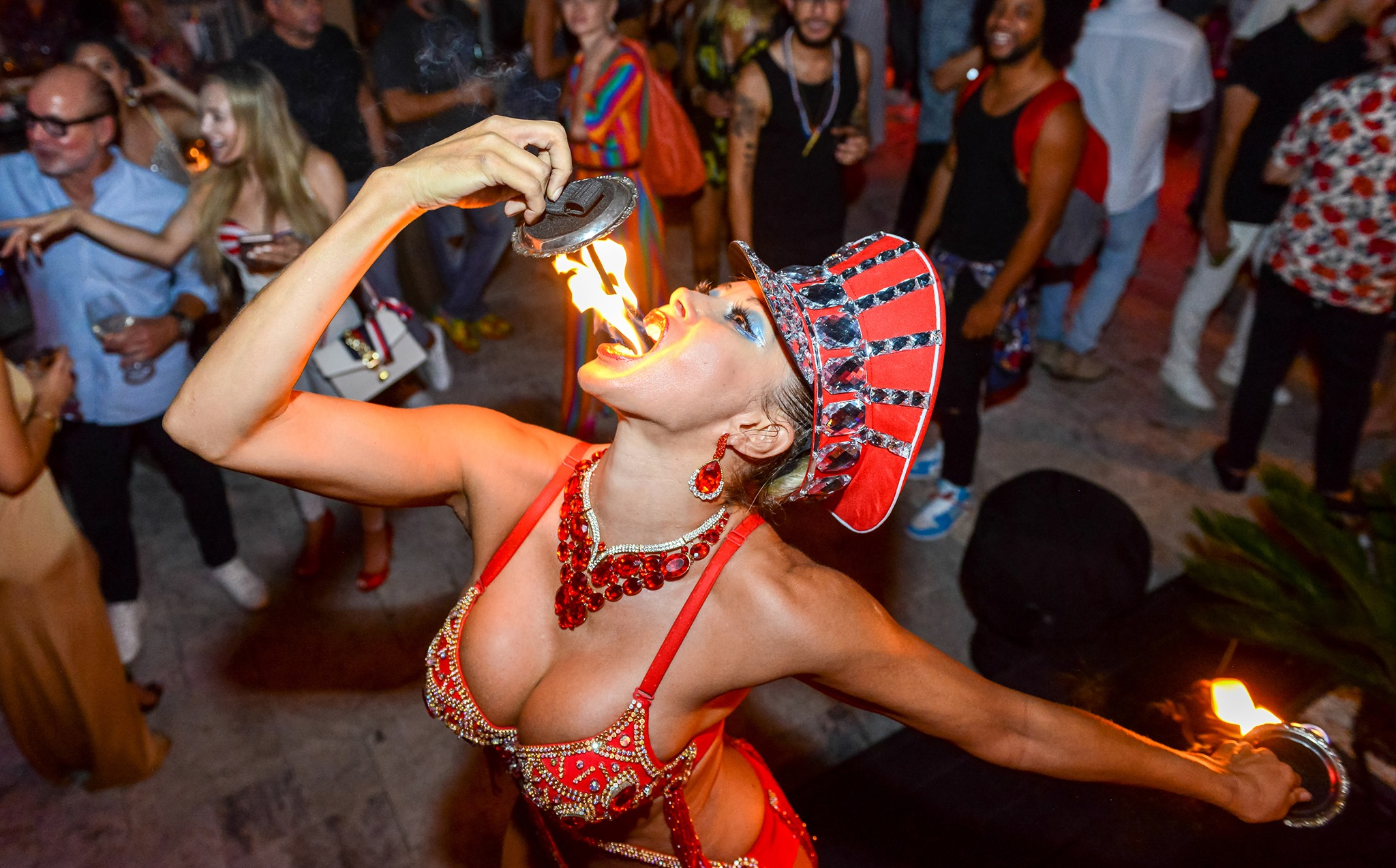 woman fire eating sword