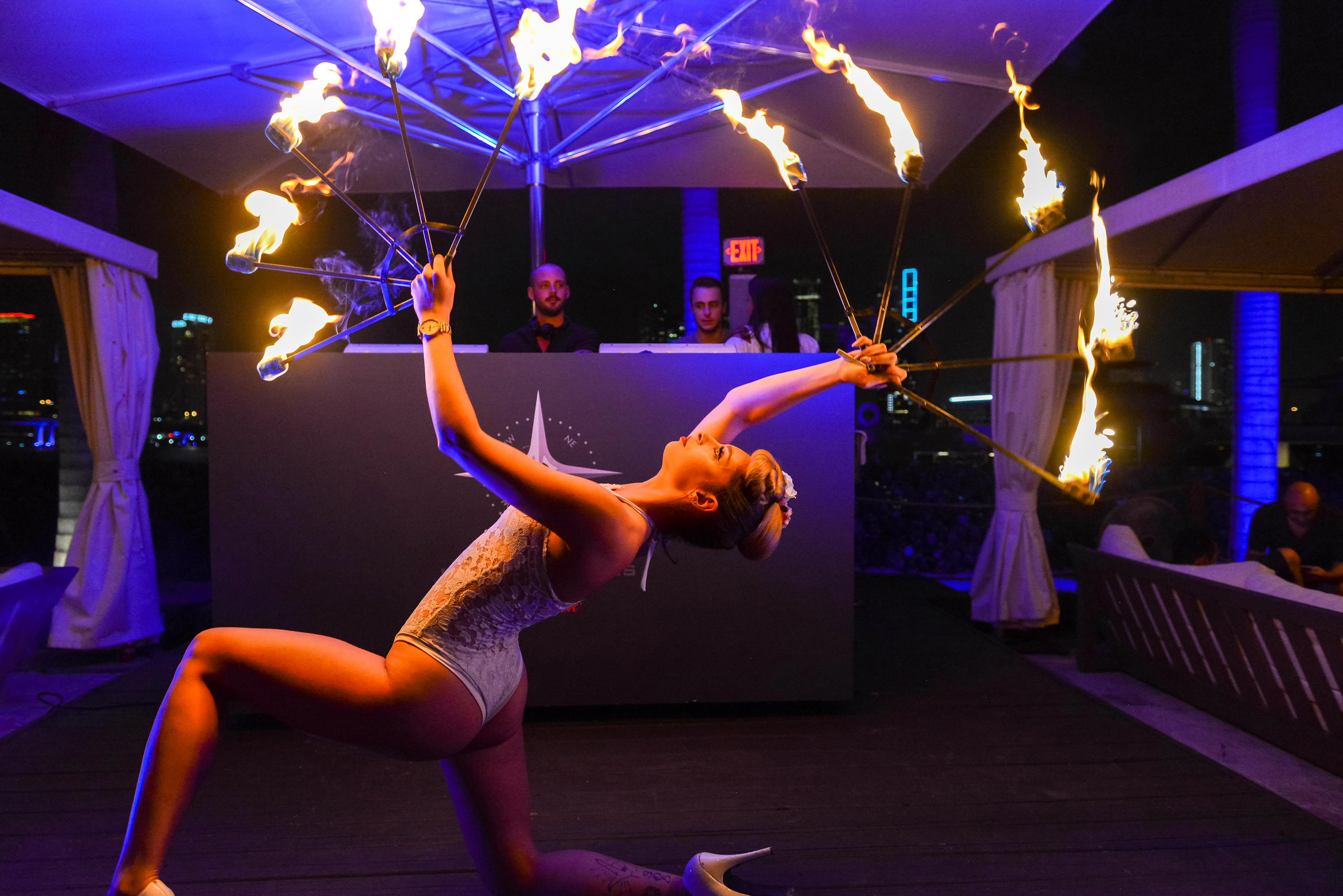 fire juggler in front of dj booth at island garden
